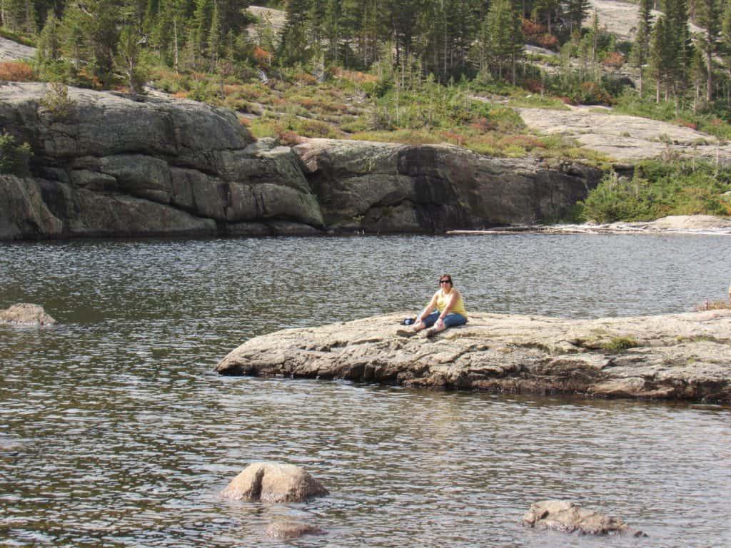 Giel sitting on big rock at Mills Lake