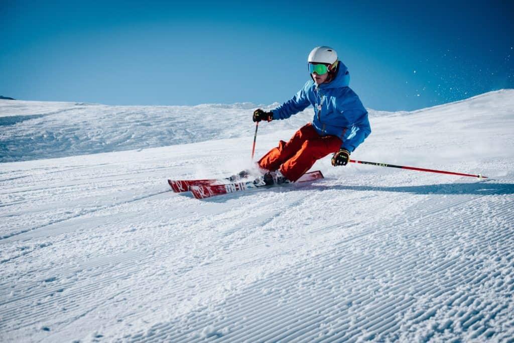 Man downhill skiing