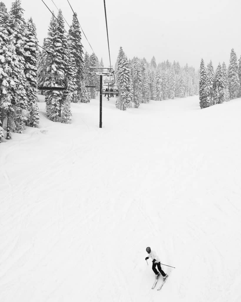 Ski lift and person skiing